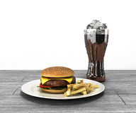 Hamburger and a glass of cola with ice on wooden table Free spac Stock Photo