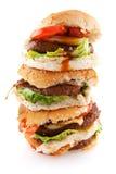 Hamburger grassi impilati Fotografia Stock