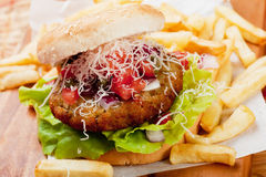 Hamburger with grated cheese Stock Image