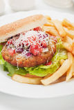 Hamburger with grated cheese Royalty Free Stock Photography