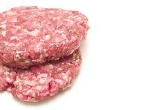 Hamburger grezzo Immagini Stock