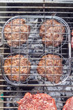 Hamburger on the grill Stock Photos