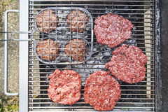 Hamburger on the grill Stock Photo