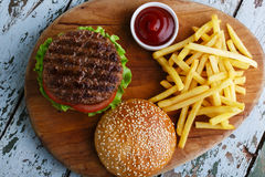 Hamburger grill. With french fries and beer royalty free stock image