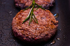 Hamburger on the grill Royalty Free Stock Image