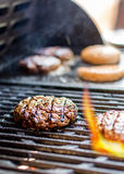 Hamburger on grill Stock Image