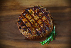 Hamburger, grilled ground beef meat patty, with grill marks. Hamburger, juicy grilled ground beef meat patty, with grill marks and rosemary Stock Photography