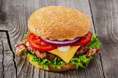 Hamburger with grilled meat cheese bacon Royalty Free Stock Images
