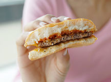 Hamburger in hand Royalty Free Stock Photography