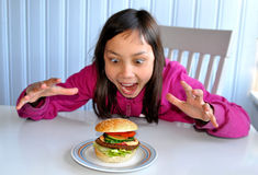 Hamburger happiness Royalty Free Stock Images