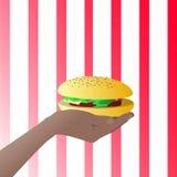 Hamburger in his hand. Illustrations Royalty Free Stock Photos