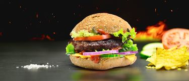 Hamburger - homemade burger with fresh vegetables Royalty Free Stock Images