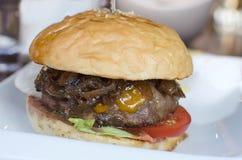 Hamburger, homemade hamburger with fresh vegetables. Big beef burger full of fresh vegetable Stock Photos