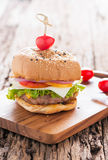 Hamburger, homemade hamburger with fresh vegetables. On old wood background royalty free stock photography