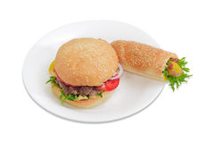 Hamburger and hot dog with frankfurter on a white dish Royalty Free Stock Photo