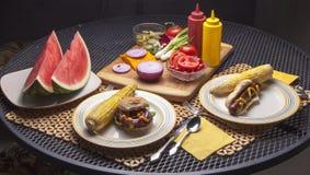 Hamburger and Hot dog on Plates. Royalty Free Stock Images