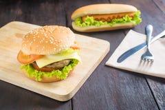 Hamburger, hot dog on the wooden background Royalty Free Stock Photography