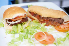Hamburger and hotdog on white plate Royalty Free Stock Images