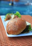 Hamburger at hotel pool Stock Photos