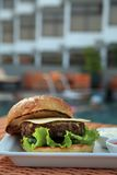 Hamburger at hotel pool Stock Images