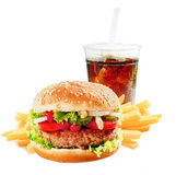 Hamburger with iced soda drink. Hamburger on a asesame bun with iced soda drink and crisp golden potato French fries on a white background stock photo