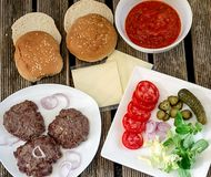 Hamburger ingredients. Ingredients for tasty homemade hamburgers stock photos