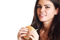 hamburger je kobiety Zdjęcia Stock