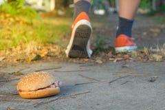 Hamburger and jogging Stock Photography