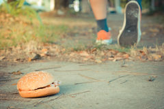 Hamburger and jogging , process in vintage style Stock Photography
