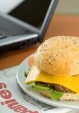 Hamburger and laptop Stock Photography