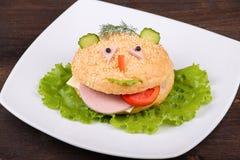 Hamburger looks like a funny muzzle, close up Stock Photography