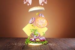 Hamburger. Making a hamburger with hands Stock Images