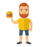 Hamburger and a man Royalty Free Stock Photos