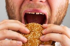Hamburger mangeur d'hommes Image stock