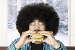 Hamburger mangeur d'hommes d'Afro Photo stock