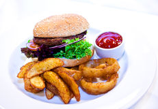 Hamburger meal. With fried potato and onion rings Royalty Free Stock Photography
