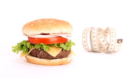 Hamburger and measuring tape Stock Photography