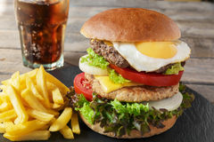 Hamburger meat cutlet egg cheese french fries stock photos