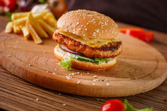 Hamburger with meat cutlet Stock Photos
