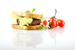 Hamburger with meat, lettuce and tomato Stock Image