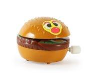 Hamburger meccanico del giocattolo di plastica isolato fotografia stock libera da diritti