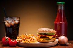 Hamburger menu. Fast food hamburger menu with burger, french fries, cola and ketchup Stock Photography
