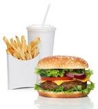 Hamburger met frieten en een koladrank Stock Foto's