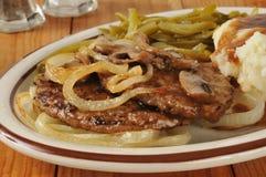 Hamburger mit Zwiebeln Stockfotos