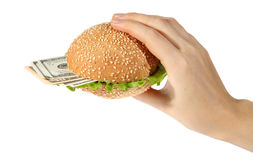 Hamburger with money in hand Stock Image
