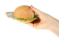 Hamburger with money in hand Royalty Free Stock Photography