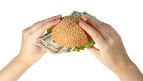 Hamburger with money in hand on white background Royalty Free Stock Photos