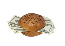 Hamburger with dollars. Hamburger with money instead of meat Royalty Free Stock Photography