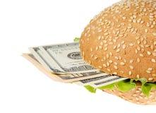 Hamburger with money on the white background Stock Photo