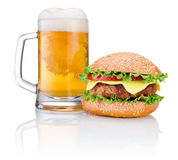 Hamburger and Mug of beer isolated on white background Royalty Free Stock Images
